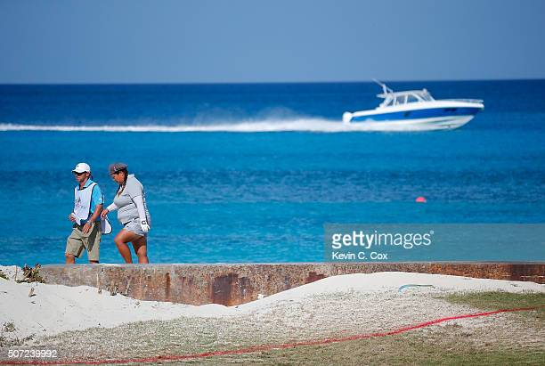 Christina Kim and her caddie walk back to eighth hole after searching for her tee shot on the beach during the first round of the Pure Silk Bahamas...
