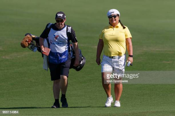 Christina Kim and her caddie walk up the fairway during the LPGA Volunteers of America Texas Classic on May 5 2018 at the Old American Golf Club in...