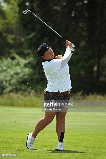 Christina Kim hits her second shot on the 13th hole during the final round of the ShopRite LPGA Classic presented by Acer on the Bay Course at the...