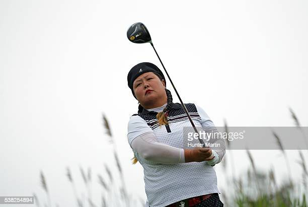 Christina Kim hits her tee shot on the third hole during the final round of the ShopRite LPGA Classic presented by Acer on the Bay Course at the...