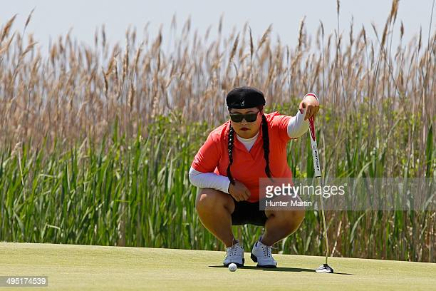 Christina Kim lines up her putt on the second hole during the final round of the ShopRite LPGA Classic presented by Acer on the Bay Course at the...