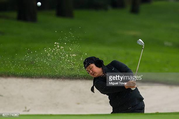 Christina Kim of San Jose California hits from a bunker during the Lorena Ochoa Invitational 2016 at Club de Golf on November 10 2016 in Mexico City...