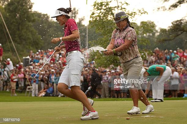 Christina Kim of the U.S. Douses Michelle Wie of the U.S. With champagne following Wie's victory at the CN Canadian Women's Open at St. Charles...