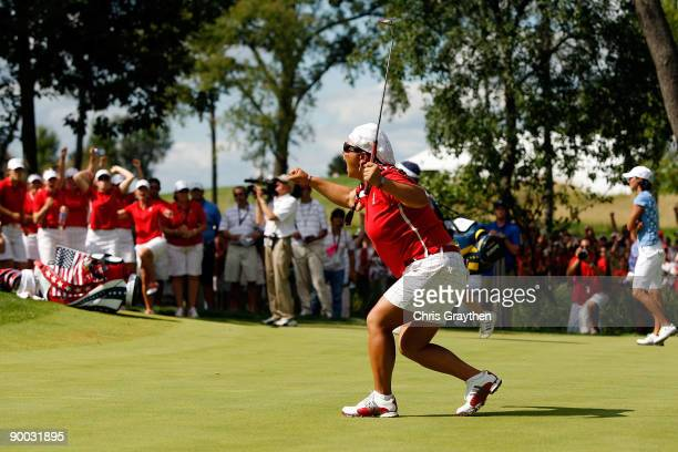 Christina Kim of the US Team celebrates after sinking a putt on the 16th green during the 2009 Solheim Cup at Rich Harvest Farms on August 23 2009 in...