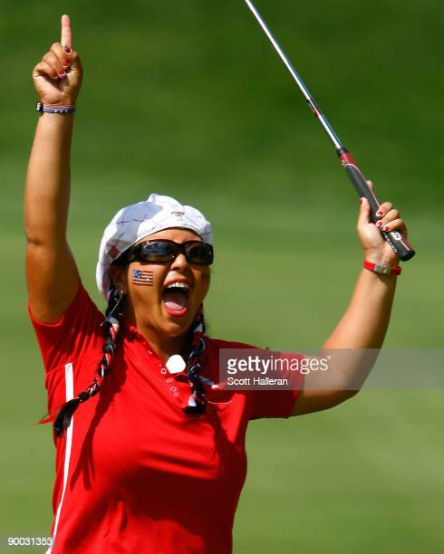 Christina Kim of the US Team celebrates after winning the 14th hole during the Sunday singles matches at the 2009 Solheim Cup at Rich Harvest Farms...