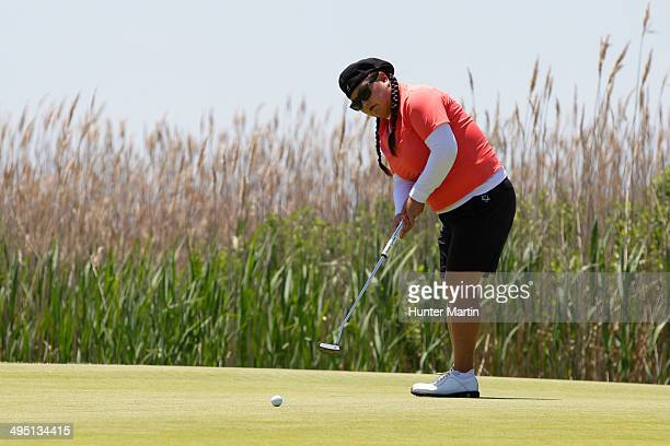 Christina Kim putts on the second hole during the final round of the ShopRite LPGA Classic presented by Acer on the Bay Course at the Stockton...