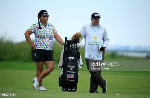 Christina Kim stands by her golf bag during the third and final round of the ShopRite LPGA Classic Presented by Acer on the Bay Course at Stockton...