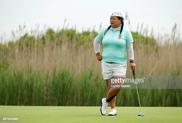 Christina Kim stands on the green on the second hole during the first round of the ShopRite LPGA Classic presented by Acer on the Bay Course at the...