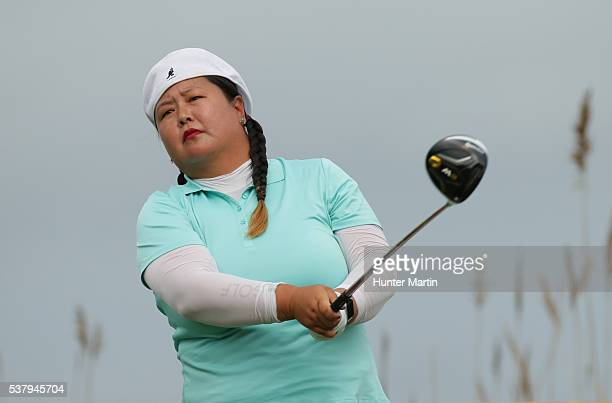 Christina Kim watches her tee shot on the third hole during the first round of the ShopRite LPGA Classic presented by Acer on the Bay Course at the...