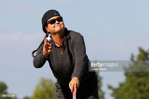 Christina Kim waves to the crowd after making birdie on the 18th hole during the first round of the ShopRite LPGA Classic presented by Acer on the...