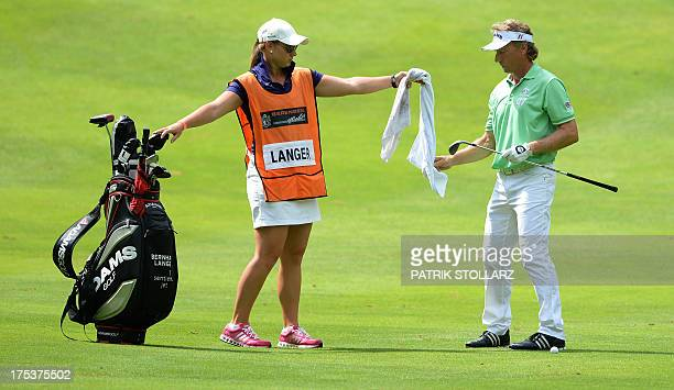 Christina Langer hand a towel to Germany´s Bernhard Langer as he competes at the second round of the Berenberg Bank Masters Cologne European Senior...