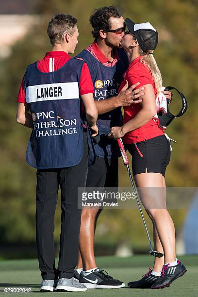 Christina Langer of Germany gets a kiss from caddy and fiance Chase De Jong on the 18th green after the first round of the PNC Father/Son Challenge...