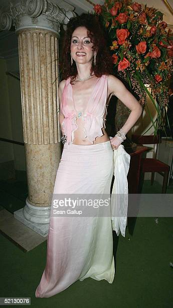 Christina Lugner poses in her La Hong dress while attending the annual Vienna Opera Ball at the Vienna State Opera on February 3 2005 in Vienna...