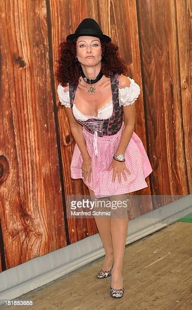 Christina Lugner wearing traditional Austrian Dirndl costume poses during the 'Wiener Wirten Tag' as part of Wiener Wiesn Festival 2013 on September...