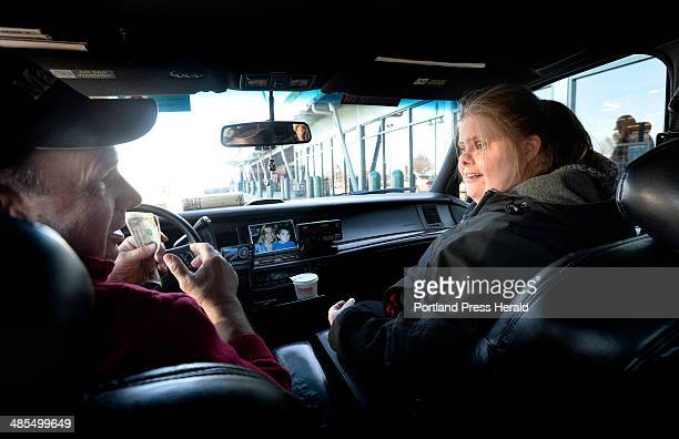 Christina Mailhot talks with taxi driver Mack McDonough before getting a ride home from the grocery store Tuesday April 1 2014