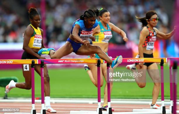 Christina Manning of the United States clears a hurdle on her way to winning her heat in the Women's 100 metres hurdles semi finals during day eight...