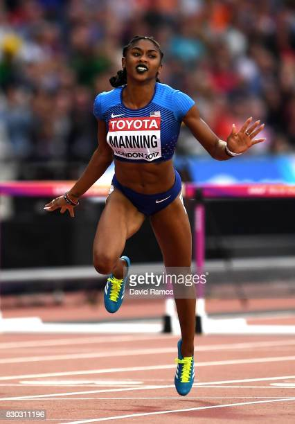 Christina Manning of the United States crosses the line to win her heat in the Women's 100 metres hurdles semi finals during day eight of the 16th...