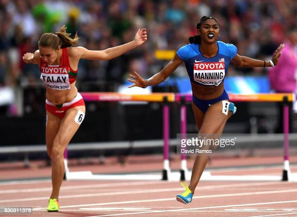 Christina Manning of the United States crosses the line to win her heat ahead of Alina Talay of Belarus in the Women's 100 metres hurdles semi finals...