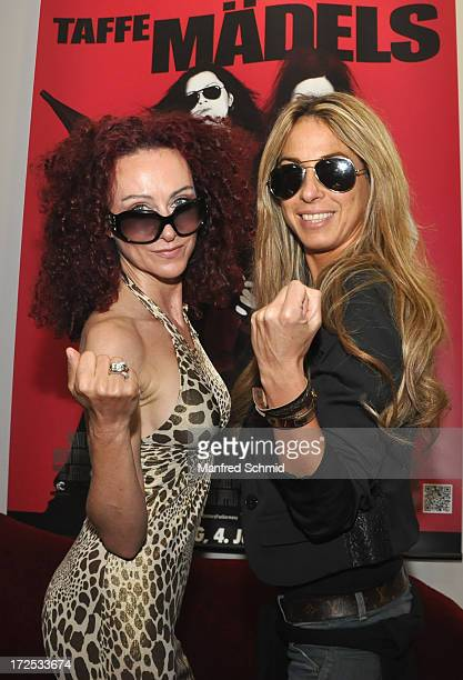 Christina Mausi Lugner and Yvonne Rueff pose for a photograph during the 'Taffe Maedls' movie premiere party at Lugner City on July 2 2013 in Vienna...