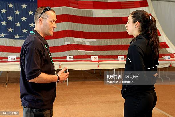 Christina McHale meets with New York fireman Jimmy Sands as she visits the National 9/11 Flag on display during the BNP Paribas Open at the Indian...