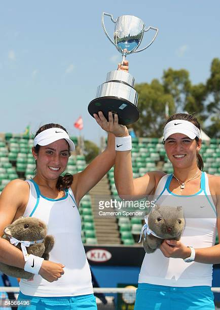 Christina McHale of the United States of America and Ajla Tomljanovic of Croatia hold aloft the championship trophy after winning their junior girls...