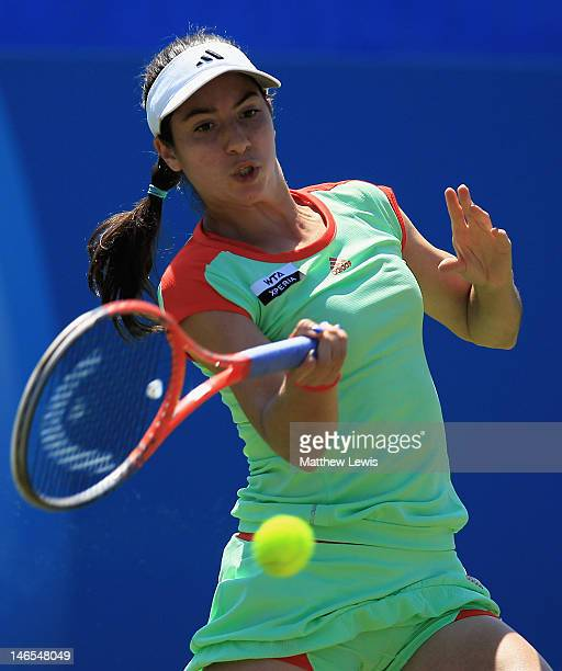 Christina McHale of the United States of America in action against Caroline Wozniacki of Denmark during day four of the AEGON International on June...