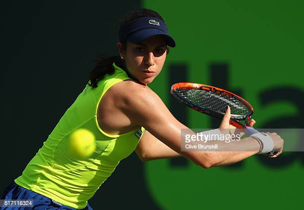 Christina McHale of the United States plays a backhand against Misaki Doi of Japan in their first round match during the Miami Open Presented by Itau...