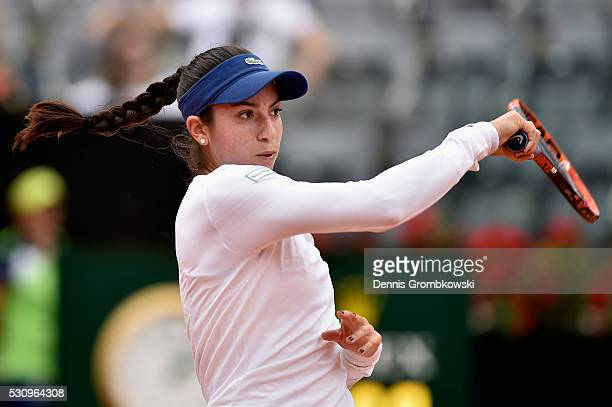 Christina Mchale of the United States plays a backhand in her match against Serena Williams of the United States on Day Five of The Internazionali...