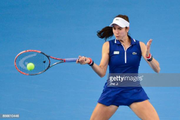Christina McHale of the United States returns a shot against Sloane Stephens of the United States during the women's singles first round on day three...