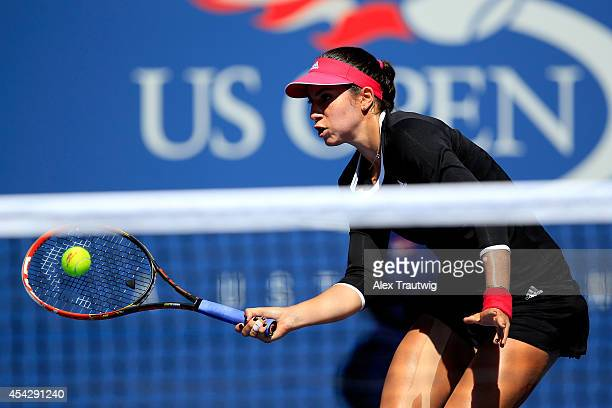 Christina McHale of the United States returns a shot against Victoria Azarenka of Belarus during their women's singles second round match on Day Four...