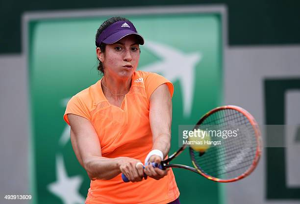 Christina Mchale of the United States returns a shot during her women's singles match against Elena Vesnina of Russia on day two of the French Open...