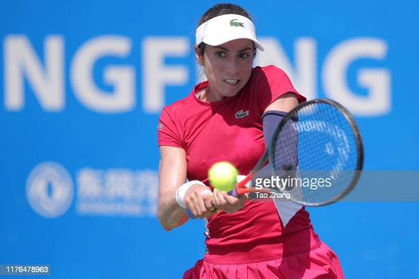 Christina mchale of the United States returns a shot during the match against Anastasija Sevastova of Latvia on Day 2 of 2019 Dongfeng Motor Wuhan...