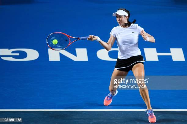 Christina McHale of the US hits a return during her women's singles second round match against China's Wang Qiang at the Hong Kong Open tennis...