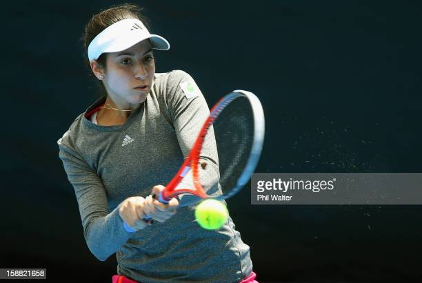Christina McHale of the USA plays a backhand in her first round match against Pauline Parmentier of France during day one of the 2013 ASB Classic on...