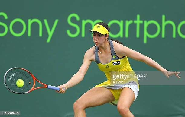 Christina McHale of the USA Roberta Vinci of italy returns a shot to Roberta Vinci of italy during day 5 of the Sony Open at the Crandon Park Tennis...
