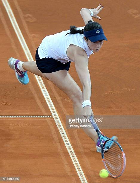 Christina McHale of the USA stretches out to play a shot during her match against Samantha Stosur of Australia in the Fed Cup tie between Australia...