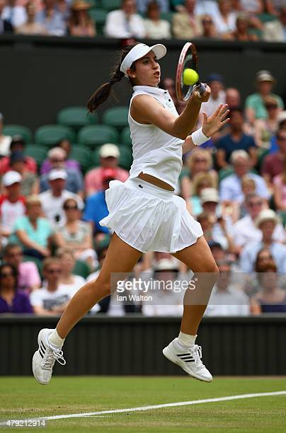 Christina McHale of USA plays a forehand in her match against Sabine Lisicki of Germany during their Women's Singles Second Round match during day...
