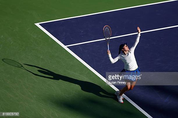 Christina McHale of USA serves to Garbine Muguruza of Spain during day six of the BNP Paribas Open at Indian Wells Tennis Garden on March 12 2016 in...