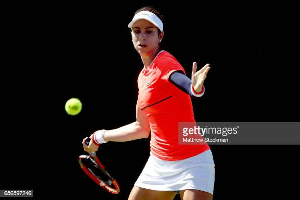 Christina McHale returns a shot to Annika Beck of Germany during the Miami Open at the Crandon Park Tennis Center on March 22 2017 in Key Biscayne...