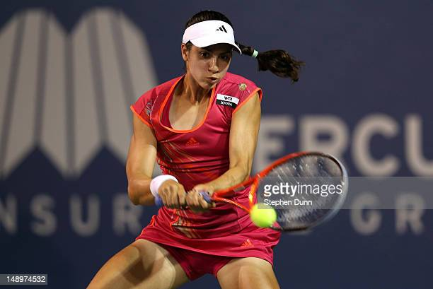 Christina McHale returns a shot to Marion Bartoli of France during day seven of the Mercury Insurance Open Presented By TriCity Medical at La Costa...