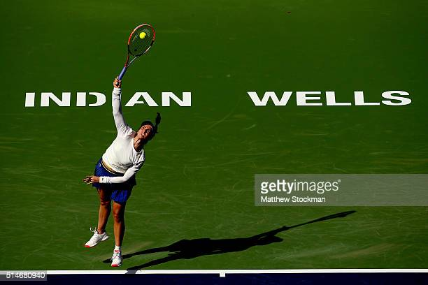 Christina McHale serves to Caroline Garcia of France during the BNP Paribas Open at the Indian Wells Tennis Garden on March 10, 2016 in Indian Wells,...