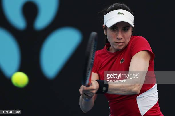 Christina McHaleof the United States plays a backhand during her first round singles match against Elise Mertens of Belgium during day four of the...