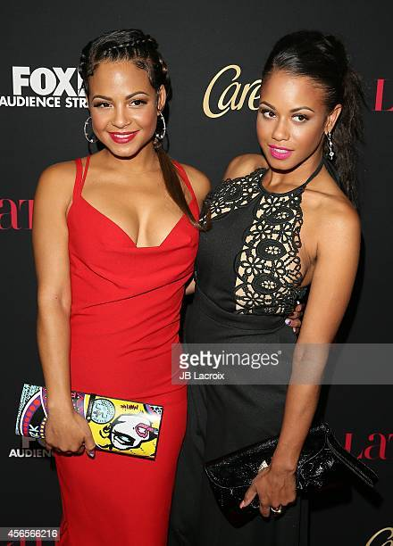 Christina Milian and Danielle Flores attend LATINA Magazine's 'Hollywood Hot List' party at the Sunset Tower Hotel on October 2, 2014 in West...