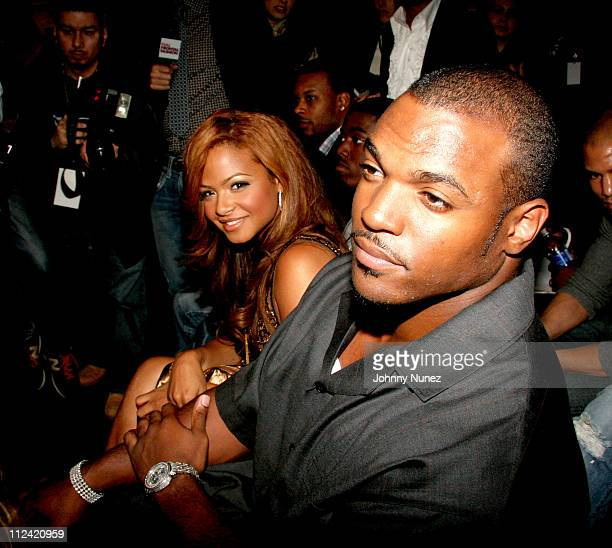 Christina Milian and Dwight Freeney during Olympus Fashion Week Fall 2006 Baby Phat Front Row and Backstage at Bryant Park in New York City New York...