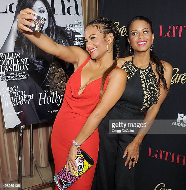"""Christina Milian and sister Danielle Flores arrive at LATINA Magazine """"Hollywood Hot List"""" party at Sunset Tower Hotel on October 2, 2014 in West..."""