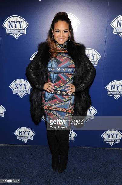 Christina Milian attends the grand opening of NYY Steak Manhattan on January 9 2014 in New York City