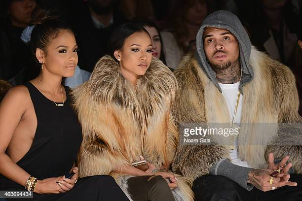 Christina Milian Karrueche Tran and Chris Brown attend the Michael Costello fashion show during MercedesBenz Fashion Week Fall 2015 at The Salon at...
