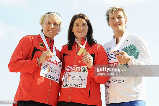Christina Obergfoll of Germany receives the silver medal Linda Stahl of Germany receives the gold medal and Barbora Spotakova of Czech Republic...