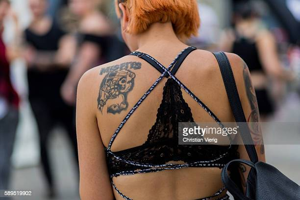 Christina Oesterhaus wearing a backless jumpsuit and black bra and tattoo at 26th Tattoo Convention Berlin 2016 on August 14, 2016 in Berlin, Germany.