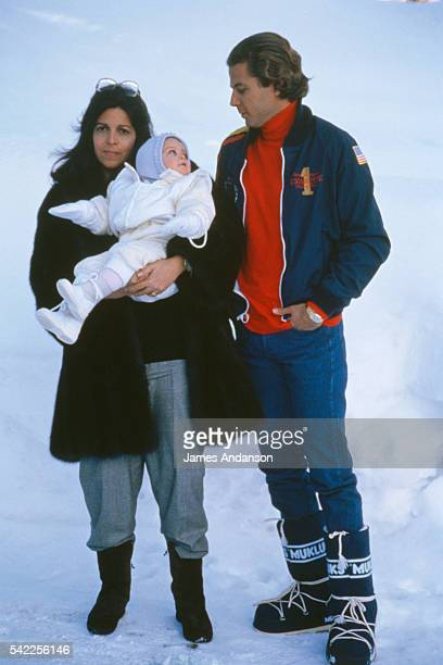 Christina Onassis holding daughter Athina Onassis Roussel aged one on vaction with her husband Thierry Roussel during their winter vacation